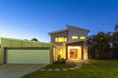 new-modern-home-exterior-stylish-dusk-49769655